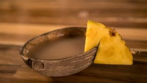 Kava Tea in a bowl with pineapple